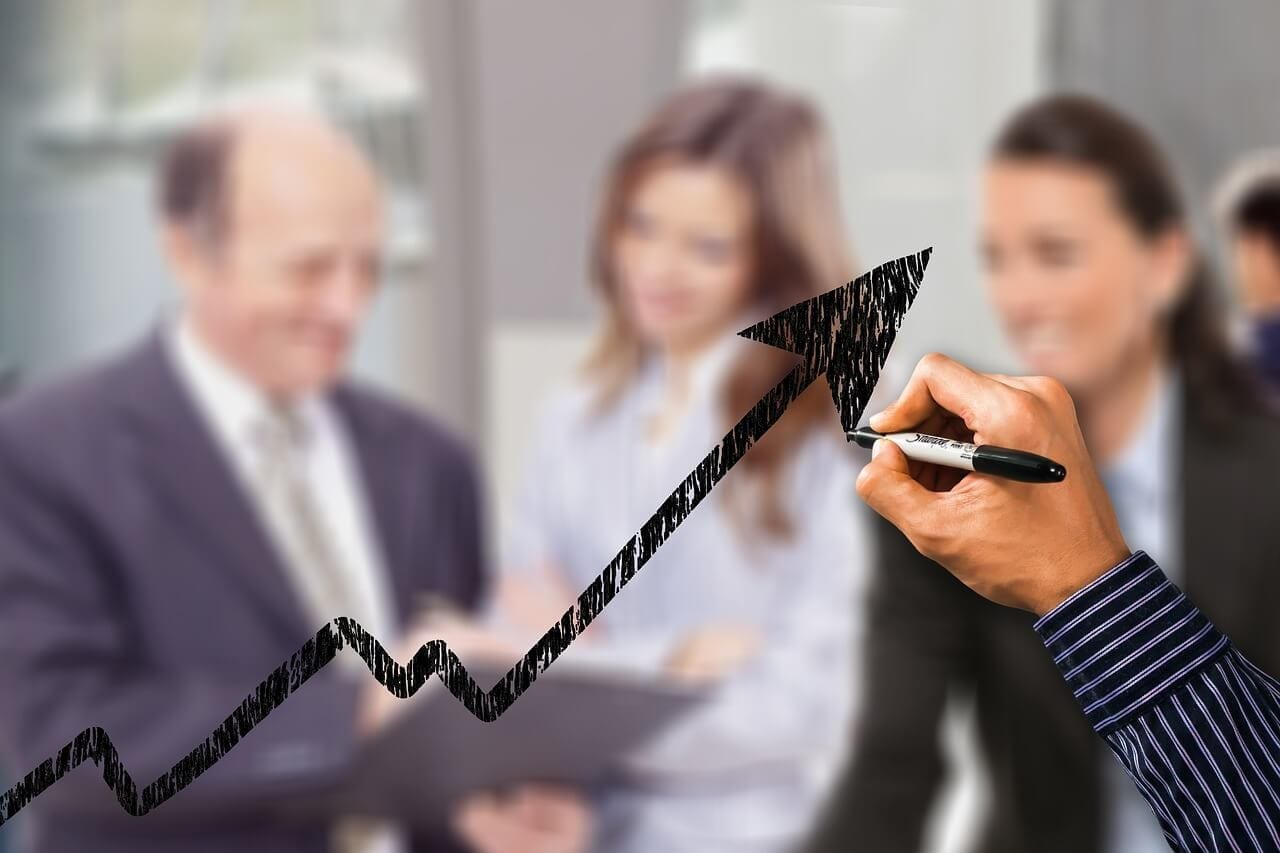 Man drawing an upwards arrow indicating business growth