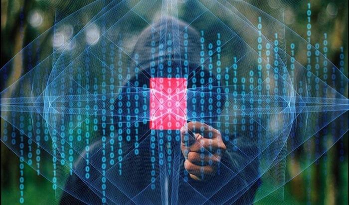Data security hacker in a black hood
