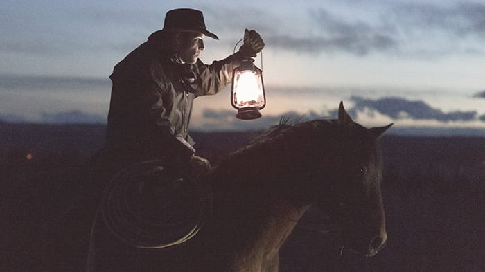 Cowboy on Horse Illuminating Path Forward