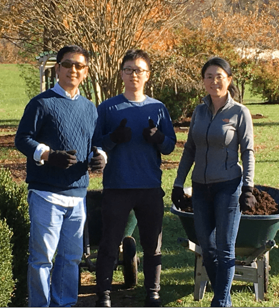 Two men and one woman gardening